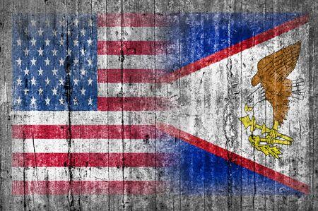 USA and American Samoa flag on concrete wall