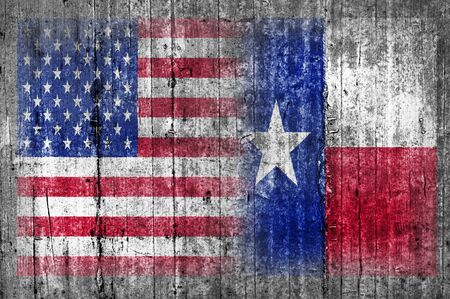 painted wood: USA and Texas flag on concrete wall Stock Photo