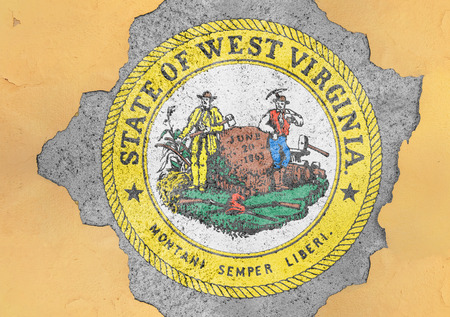 US state West Virginia seal flag in big concrete cracked hole and broken material facade structure