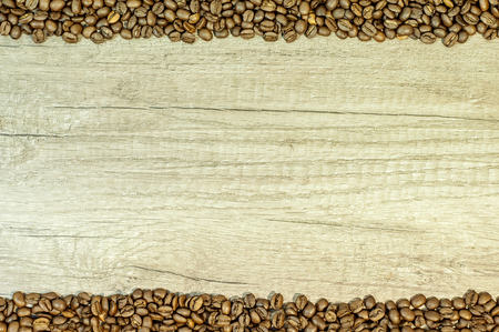 Coffee grains on kitchen table background with copy space Reklamní fotografie
