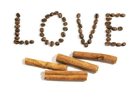 The word love written from side with coffee beans and frame made of coffee beans Imagens