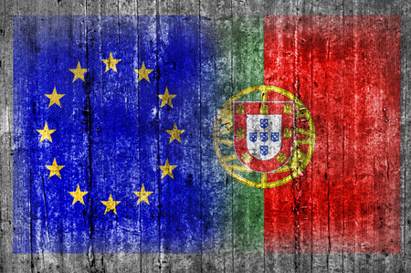 EU and Portugal flag on concrete wall 版權商用圖片