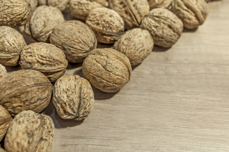 Lot of walnut close on white table Stok Fotoğraf