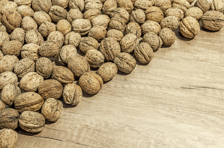 Lot of walnuts on wooden table