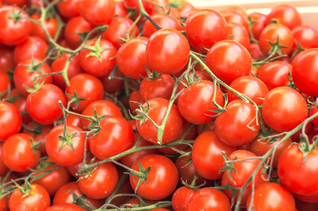 Ripe red cherry tomatoes on the market close up