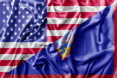 Ruffled waving United States of America and Guam flag