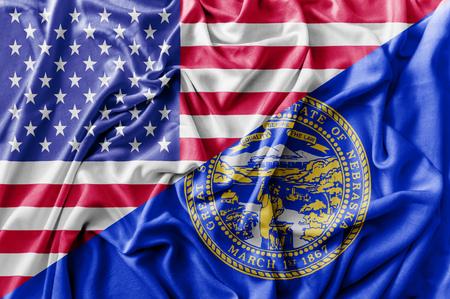 Ruffled waving United States of America and Nebraska flag