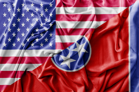Ruffled waving United States of America and Tennessee flag