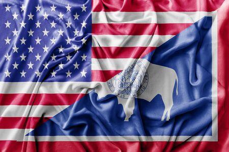 Ruffled waving United States of America and Wyoming flag