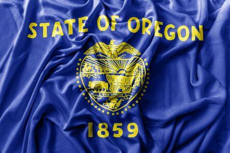 Ruffled waving United States Oregon flag Zdjęcie Seryjne