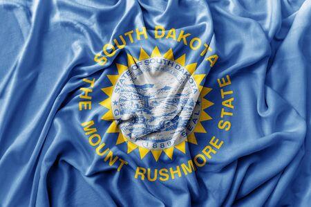 Ruffled waving United States South Dakota flag