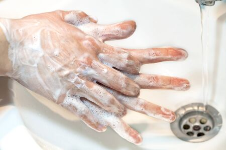 Washing of hands with soap under running water, close up Zdjęcie Seryjne