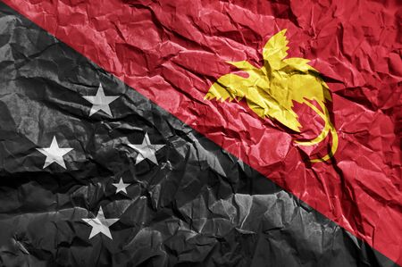 Papua New Guinea flag painted on crumpled paper background Stock Photo