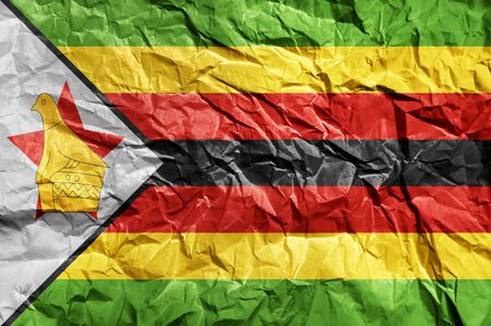 Zimbabwe flag painted on crumpled paper background Archivio Fotografico