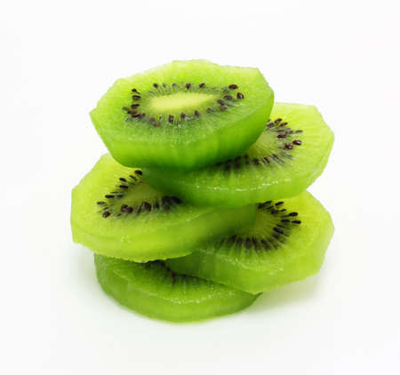 Fresh pieces kiwi fruit isolated on white background  photo
