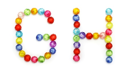 alphabet made of colorful beads isolated on white background  photo