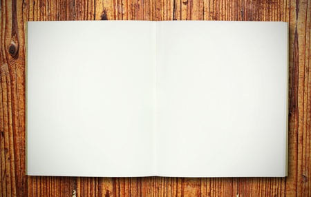 blank note book on wood texture Stock Photo - 10011194