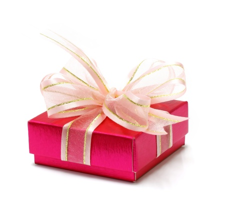 Pink gift wrapped present with rosy satin ribbon bow isolated on white  Stock Photo