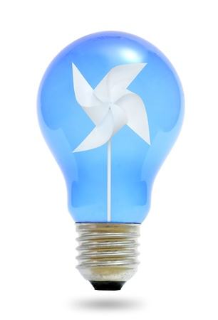Paper windmill in a blue light bulb. Stock Photo - 10142641