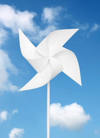 toy windmill over blue sky  photo