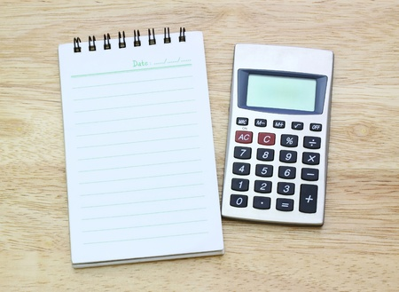 calculator and notebook on table  Banco de Imagens