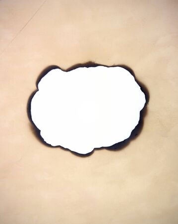 burnt paper: vintage old paper hole burned space for picture or text