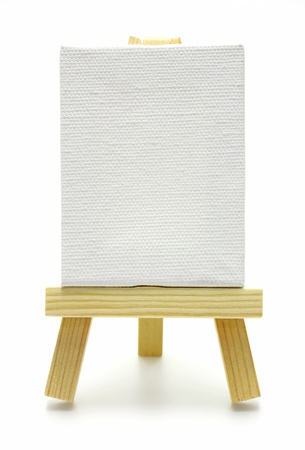 wood easel with white canvas isolated  photo