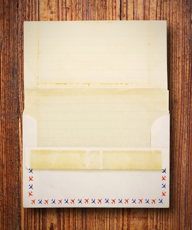 Stained vintage letter and envelope, Blank for your own text on wood background  photo