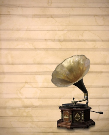 listen to music: Old bronze Phonograph, vintage old music sheet