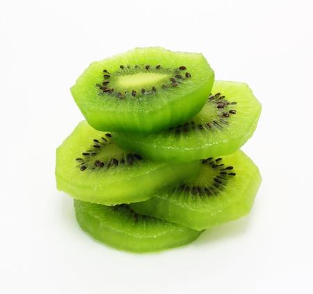 fruit: Fresh pieces kiwi fruit isolated on white background