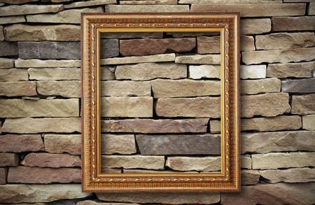 golden frame on old brick wall  photo