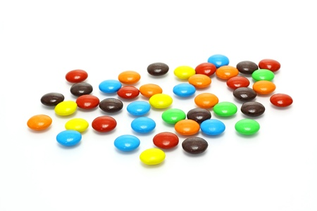 lots of colorful candies spread on white background  photo