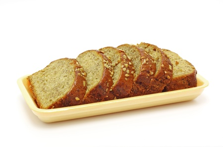 bread slice: A fresh homemade loaf of banana walnut bread.