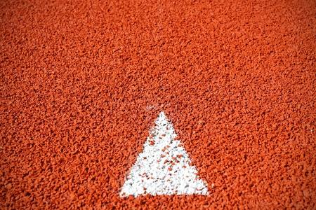 una muestra de la flecha en la pista de atletismo Foto de archivo - 10339449