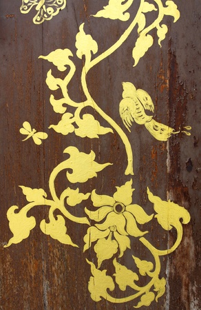 gold painting on old wood door Stock Photo - 10400955
