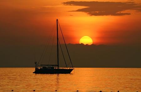 Yacth in sunset at kata beach  photo