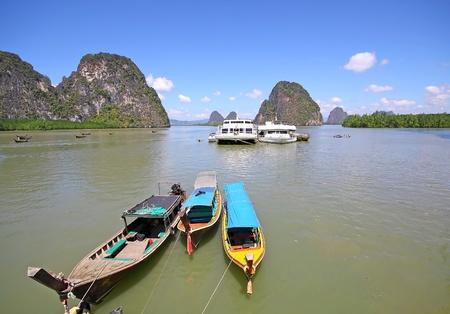 longtail boat, Blue sky at phangnga bay photo