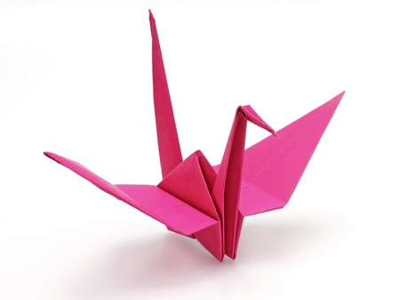 origami bird: Pink origami bird on white background