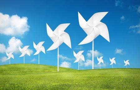 pinwheel: paper toy windmill in green grass field Stock Photo