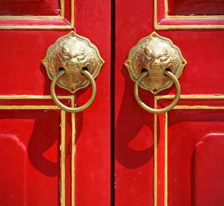 Red chinese door with a lion head. Stock Photo