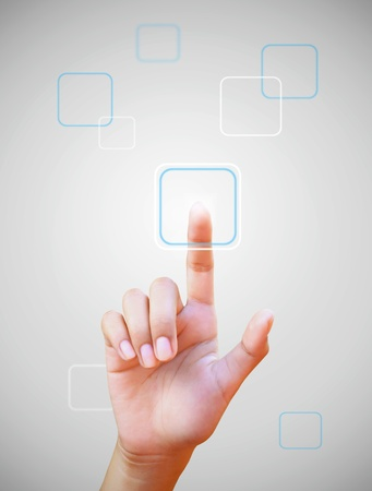 hand pushing a button on a touch screen Stock Photo - 11030758