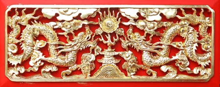 Golden dragon(Chinese: Long) wood carving in Red background photo