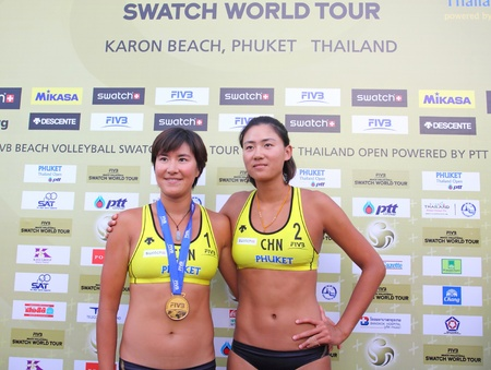 PHUKET, THAILAND - NOVEMBER 6: china  players celebrate winner award of the SWATCH FIVB World Tour 2011 on November 6, 2011 at Karon Beach in Phuket, Thailand