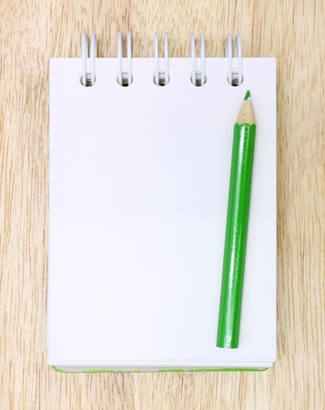 Color Pencil and notebook on Wood Stock Photo - 11410192