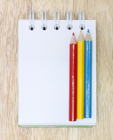 Color Pencil and notebook on Wood Stock Photo - 11410196