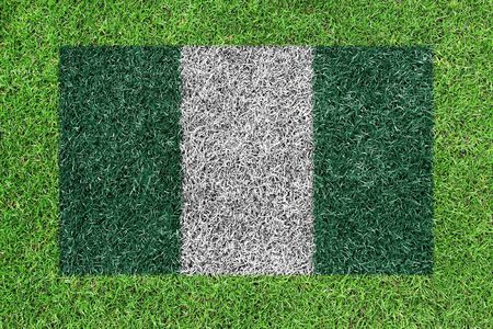 nigeria: nigeria flag as a painting on green grass Stock Photo