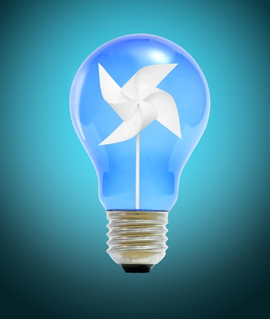 Paper windmill in a blue light bulb. Stock Photo - 12030087