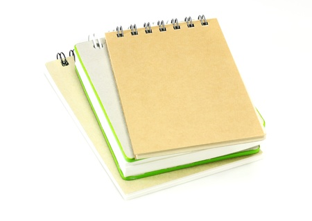 stack of ring binder book or notebook on white  photo