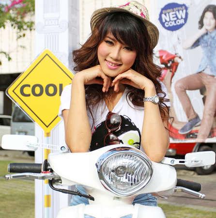 PHUKET, THAILAND - JANUARY 28: Unidentified female presenter at Yamaha Filano booth in PHUKET CHINESE NEW YEAR FESTIVAL 2012 on January 28, 2012 in Phuket, Thailand. Stock Photo - 12590866