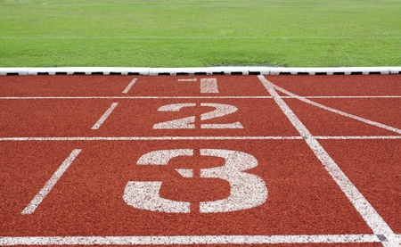 Running track numbers one two three in stadium  photo